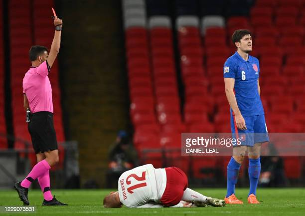 England's defender Harry Maguire is red-carded for a tackle on Denmark's striker Kasper Dolberg during the UEFA Nations League group A2 football...