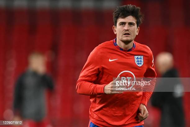 England's defender Harry Maguire warms up before the UEFA Nations League group A2 football match between England and Denmark at Wembley stadium in...