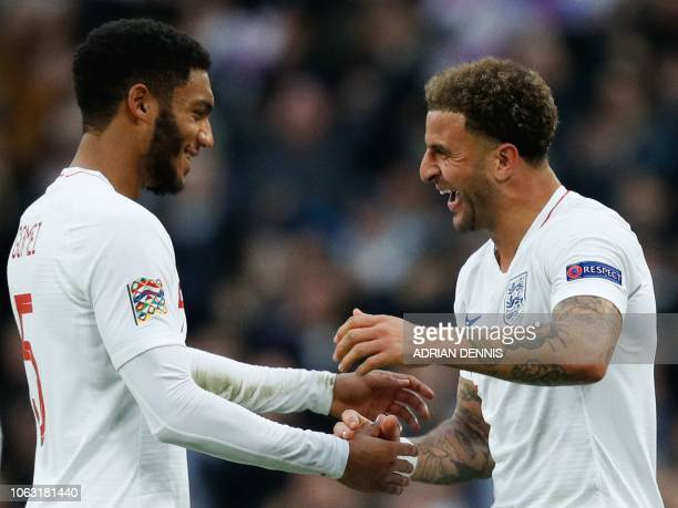 England's defender Joe Gomez and England's defender Kyle Walker celebrate on the pitch after the international UEFA Nations League football match...