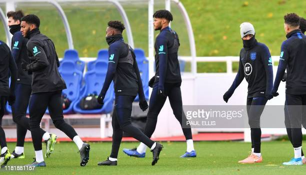 England's defender Joe Gomez and England's midfielder Raheem Sterling attend an England team training session at St George's Park in BurtononTrent...