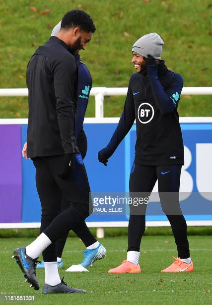 England's defender Joe Gomez and England's midfielder Raheem Sterling attend an England team training session at St George's Park in Burton-on-Trent,...