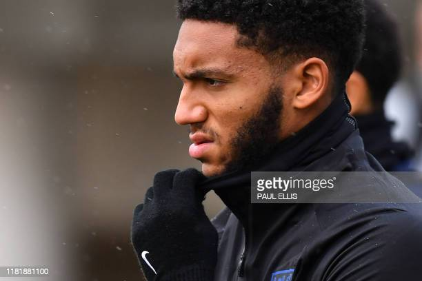 England's defender Joe Gomez arrives to attend an England team training session at St George's Park in Burton-on-Trent, central England on November...