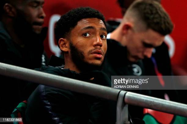 England's defender Joe Gomez takes his place on the bench for the UEFA Euro 2020 qualifying first round Group A football match between England and...