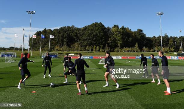 England's defender Joe Gomez vies for the ball during an open training session at St George's Park in BurtononTrent central England on October 9 2018...