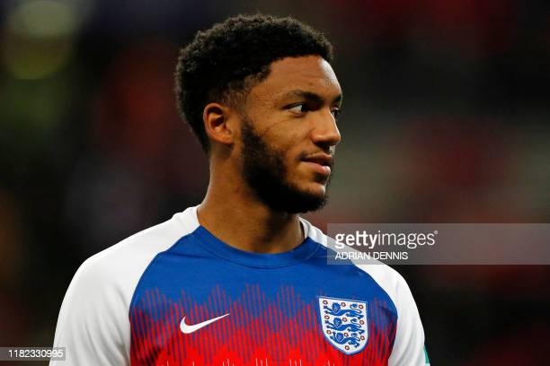 England's defender Joe Gomez warms up ahead of the UEFA Euro 2020 qualifying first round Group A football match between England and Montenegro at...