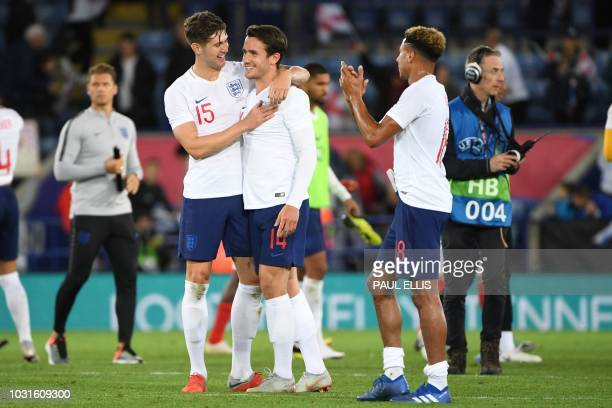 England's defender John Stones embraces England's midfielder Ben Chilwell after winning a friendly international football match between England and...