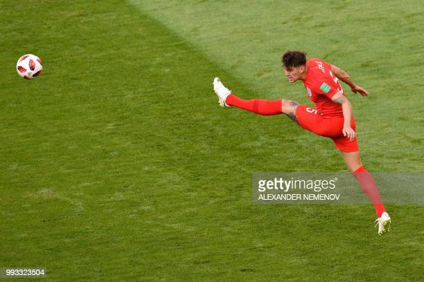 TOPSHOT England's defender John Stones kicks the ball during the Russia 2018 World Cup quarterfinal football match between Sweden and England at the...