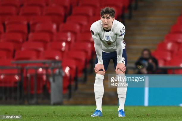 England's defender John Stones reacts after Poland's first goal during the FIFA World Cup Qatar 2022 Group I qualification football match between...