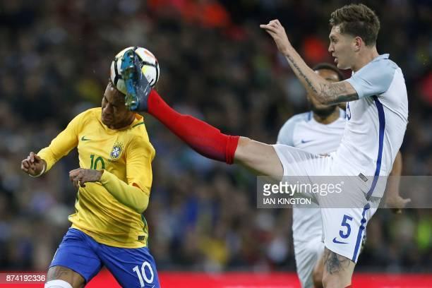 TOPSHOT England's defender John Stones vies with Brazil's striker Neymar during the international friendly football match between England and Brazil...