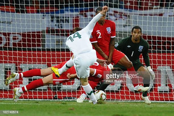 England's defender John Terry deflects a shot by Slovenia's striker Zlatko Dedic in front of England's goalkeeper David James during the Group C...