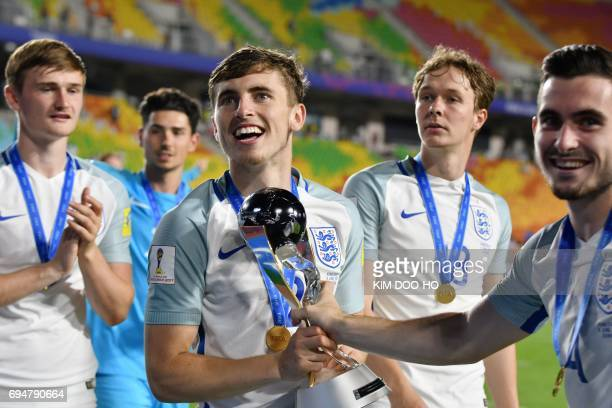 England's defender Jonjoe Kenny celebrate with the trophy after victory in the U20 World Cup final football match between England and Venezuela in...