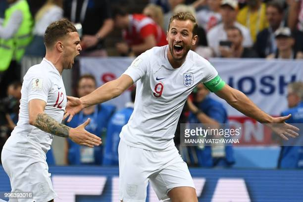 England's defender Kieran Trippier celebrates his opening goal with England's forward Harry Kane during the Russia 2018 World Cup semifinal football...