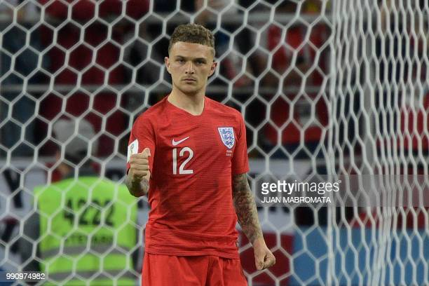 England's defender Kieran Trippier celebrates scoring during the penalty shootout at the end of the Russia 2018 World Cup round of 16 football match...