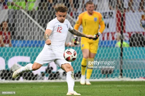 England's defender Kieran Trippier clears the ball during the Russia 2018 World Cup semifinal football match between Croatia and England at the...