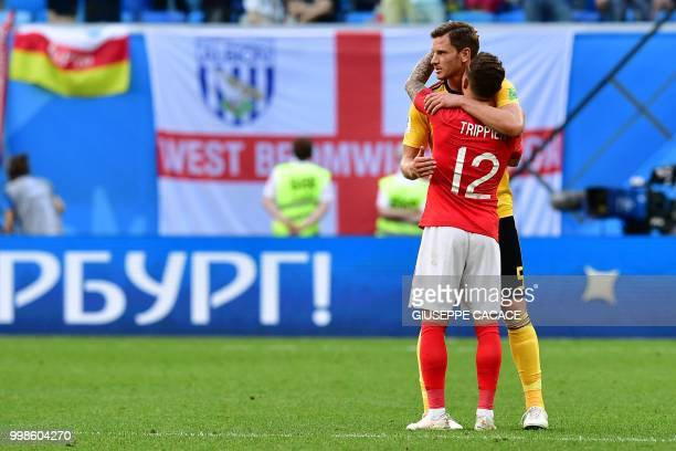 England's defender Kieran Trippier is comforted by Belgium's defender Jan Vertonghen after Belgium's victory at the end of their Russia 2018 World...