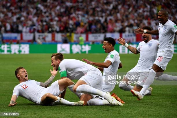 TOPSHOT England's defender Kieran Trippier is congratulated by England's forward Harry Kane after scoring a goal during the Russia 2018 World Cup...