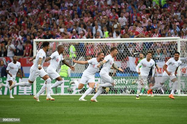 England's defender Kieran Trippier runs to celebrates his opening goal during the Russia 2018 World Cup semifinal football match between Croatia and...