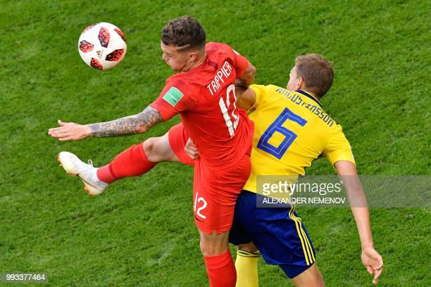 England's defender Kieran Trippier vies for the ball with Sweden's defender Ludwig Augustinsson during the Russia 2018 World Cup quarterfinal...