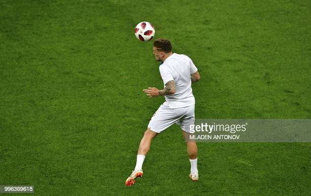 England's defender Kieran Trippier warms up prior to the Russia 2018 World Cup semifinal football match between Croatia and England at the Luzhniki...
