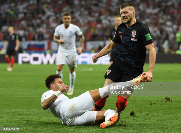 England's defender Kyle Walker fouls Croatia's forward Ante Rebic during the Russia 2018 World Cup semi-final football match between Croatia and...