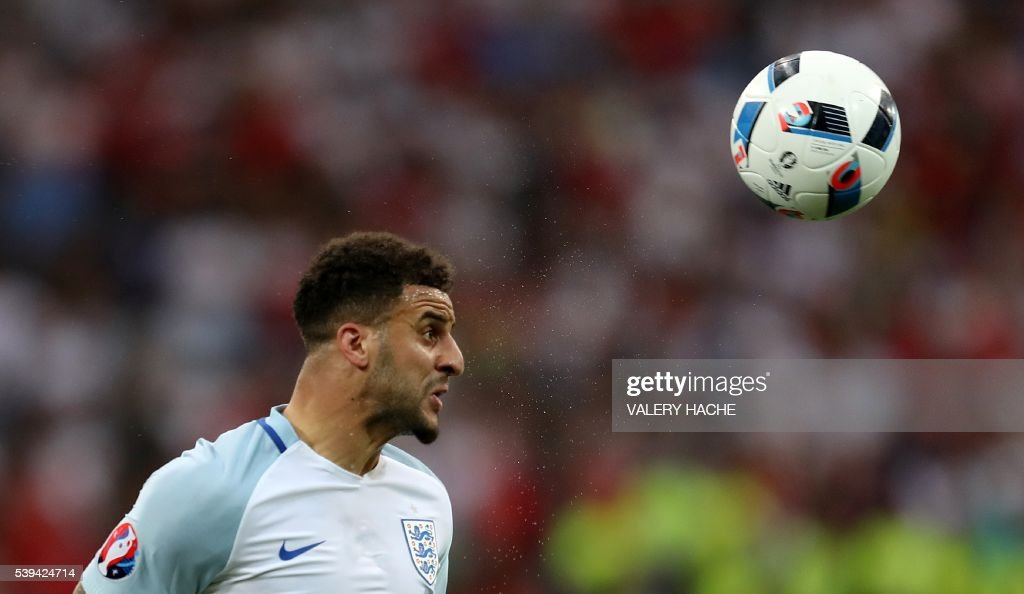 TOPSHOT - England's defender Kyle Walker heads the ball during the Euro 2016 group B football match between England and Russia at the Stade Velodrome in Marseille on June 11, 2016. / AFP PHOTO / Valery HACHE