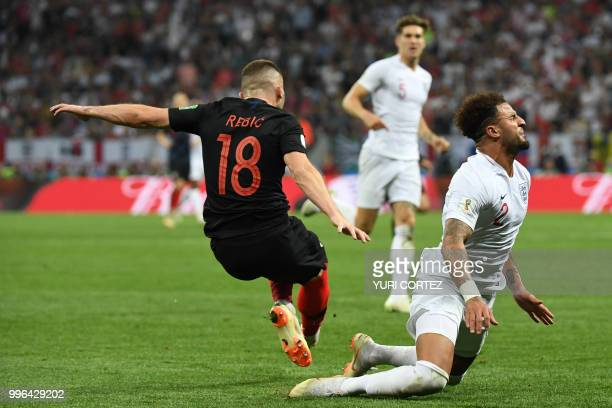 TOPSHOT England's defender Kyle Walker is fouled by Croatia's forward Ante Rebic during the Russia 2018 World Cup semifinal football match between...