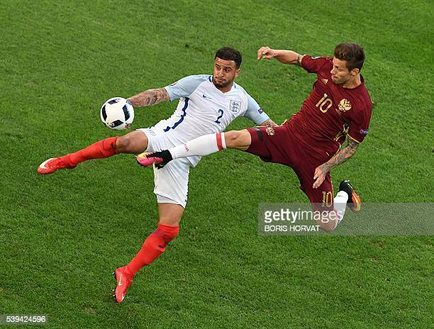 TOPSHOT England's defender Kyle Walker vies with Russia's forward Fedor Smolov during the Euro 2016 group B football match between England and Russia...