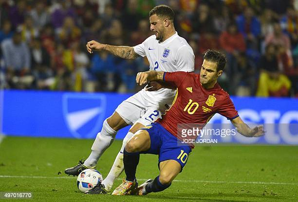 England's defender Kyle Walker vies with Spain's midfielder Cesc Fabregas during the friendly football match Spain vs England at the Jose Rico Perez...
