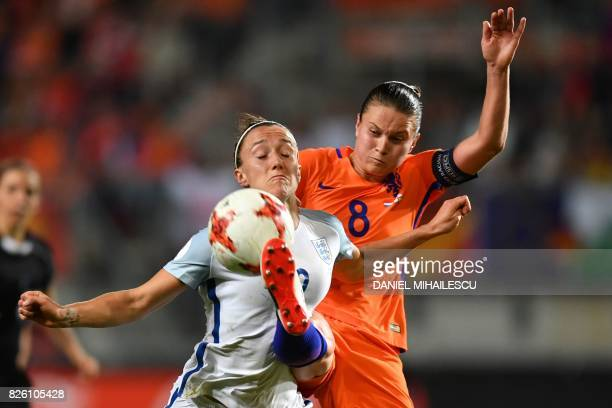 England's defender Lucia Bronze vies for the ball with Netherlands' midfielder Sherida Spitse during the UEFA Womens Euro 2017 football tournament...