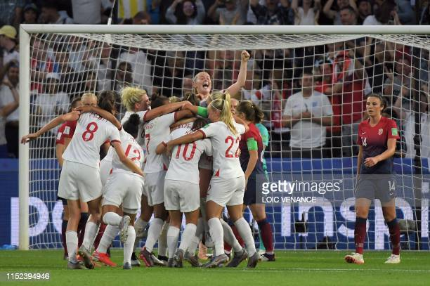 TOPSHOT England's defender Lucy Bronze celebrates with teammates after scoring a goal during the France 2019 Women's World Cup quarterfinal football...