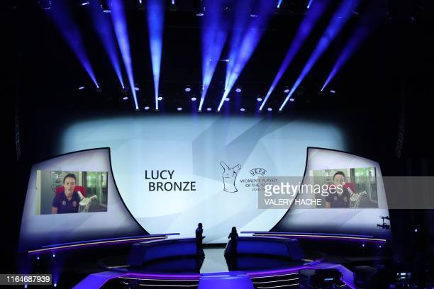 England's defender Lucy Bronze is seen on screen after winning the UEFA Women's Player of the Year award during the UEFA Champions League football...