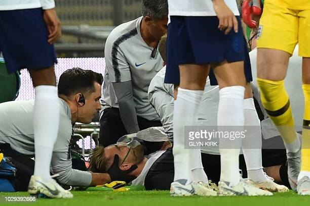 England's defender Luke Shaw receives medical attention after a clash with Spain's defender Dani Carvajal during the UEFA Nations League football...