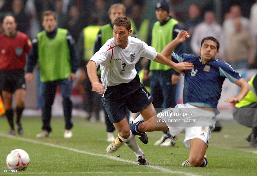 England's defender Luke Young (L) vies with Argentine midfielder Juan Roman Riquelme during England vs Argentina friendly, 12 November 2005, at the Geneva stadium in Geneva.