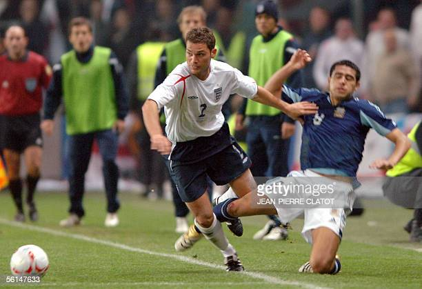 England's defender Luke Young vies with Argentine midfielder Juan Roman Riquelme during England vs Argentina friendly 12 November 2005 at the Geneva...