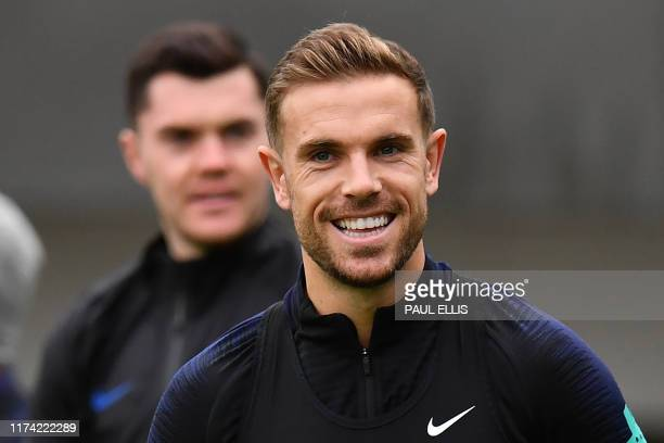 England's defender Michael Keane and England's midfielder Jordan Henderson attends an England team training session at St George's Park in...