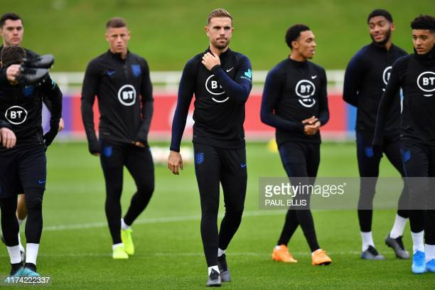 England's defender Michael Keane England's midfielder Ross Barkley England's midfielder Jordan Henderson England's defender Trent AlexanderArnold...