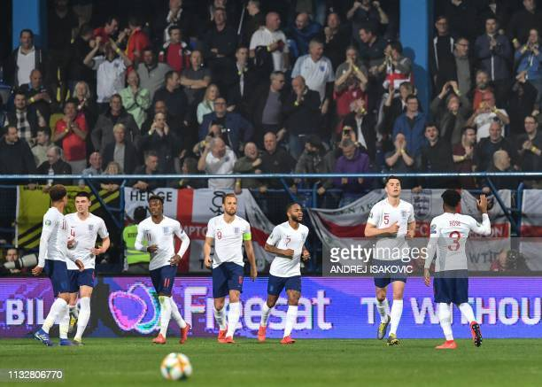 England's defender Michael Keane is congratulated by England's midfielder England's defender Danny Rose after scoring a goal during the Euro 2020...