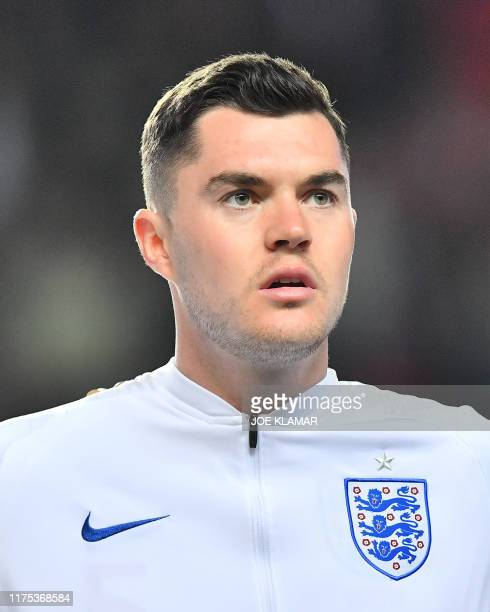 England's defender Michael Keane listens to the national anthem prior to the UEFA Euro 2020 qualifier Group A football match Czech Republic v England...