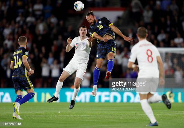 England's defender Michael Keane vies with Kosovo's forward Vedat Muriqi during the UEFA Euro 2020 qualifying Group A football match between England...