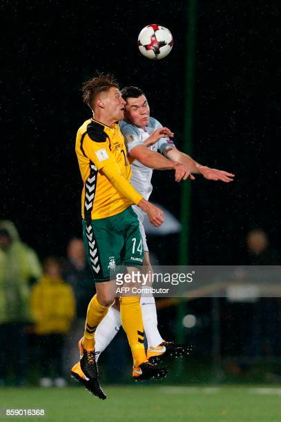 England's defender Michael Keane vies with Lithuania's midfielder Vykintas Slivka during the 2018 FIFA World Cup European Qualifying match between...