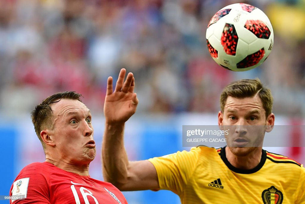 England's defender Phil Jones (L) eyes the ball with Belgium's defender Jan Vertonghen during their Russia 2018 World Cup play-off for third place football match between Belgium and England at the Saint Petersburg Stadium in Saint Petersburg on July 14, 2018. (Photo by Giuseppe CACACE / AFP) / RESTRICTED