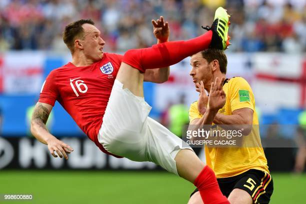 England's defender Phil Jones makes a bicycle kick past Belgium's defender Jan Vertonghen during their Russia 2018 World Cup playoff for third place...
