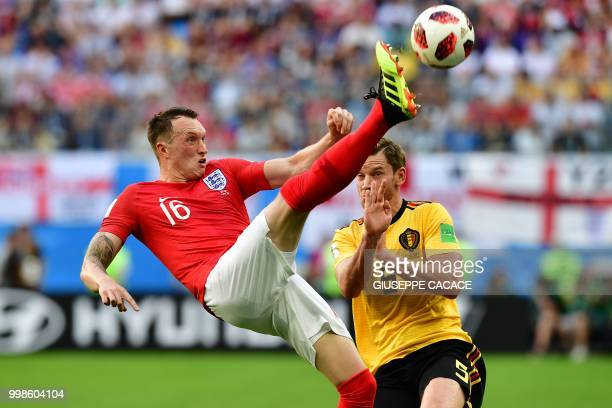TOPSHOT England's defender Phil Jones makes a bicycle kick past Belgium's defender Jan Vertonghen during their Russia 2018 World Cup playoff for...