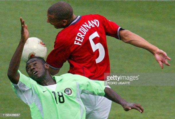 England's defender Rio Ferdinand battles for the ball with Nigeria's forward Benedict Akwuegbu during match 38 group F of the 2002 FIFA World Cup...