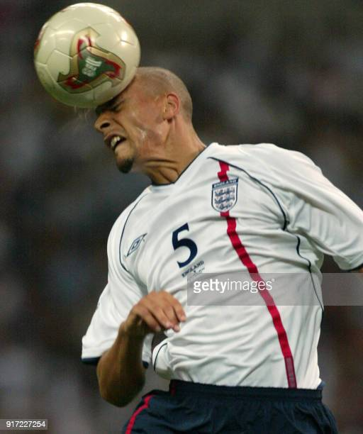 England's defender Rio Ferdinand heads the ball during match 5 group F of the 2002 FIFA World Cup Korea Japan opposing England and Sweden in Saitama...