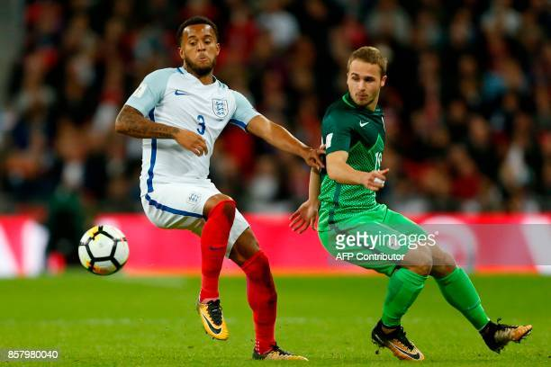 England's defender Ryan Bertrand competes with Slovenia's midfielder Jan Repas during the FIFA World Cup 2018 qualification football match between...