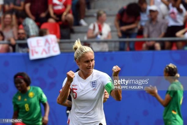 TOPSHOT England's defender Steph Houghton celebrates after scoring a goal during the France 2019 Women's World Cup round of sixteen football match...