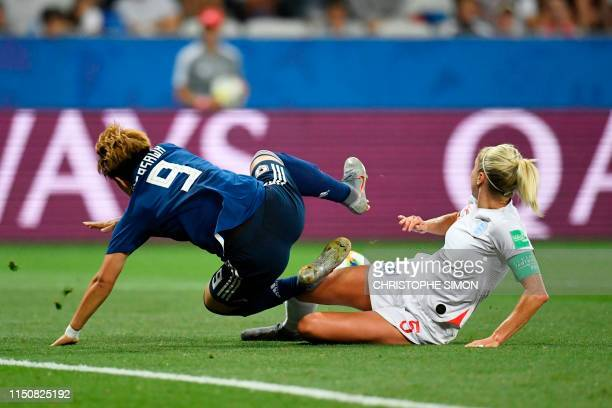 England's defender Steph Houghton vies for the ball with Japan's forward Yuika Sugasawa during the France 2019 Women's World Cup Group D football...