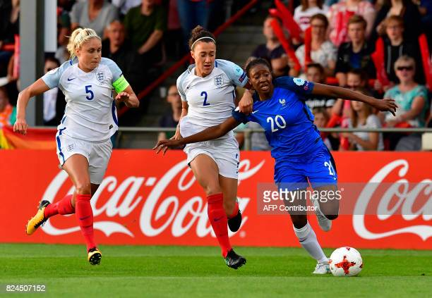 England's defender Stephanie Houghton and England's defender Lucia Bronze vie with France's forward Kadidiatou Diani during the UEFA Women's Euro...