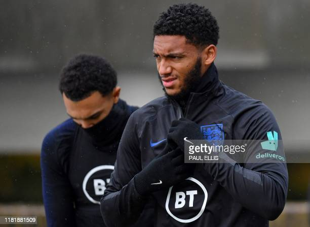 England's defender Trent Alexander-Arnold and England's defender Joe Gomez attends an England team training session at St George's Park in...